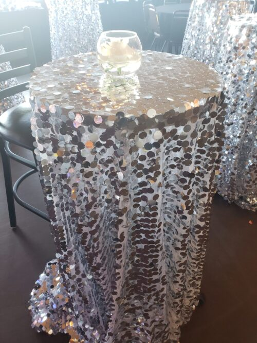 120 in. Round Payette Sequin Tablecloth Silver for rent